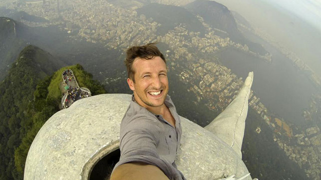 English photographer Lee Thompson at the top of the Christ the Redeemer statue.