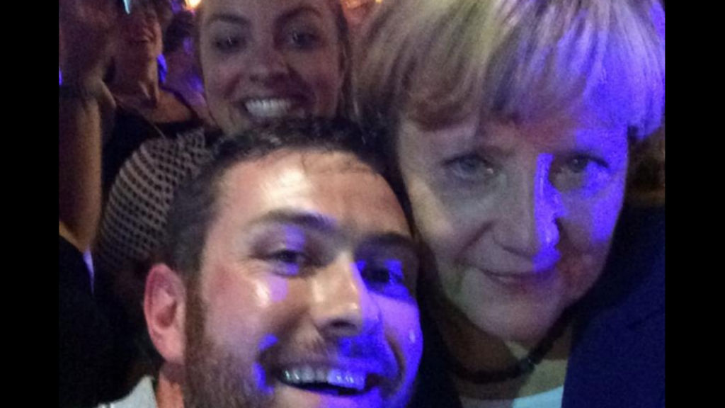 Angela Merkel poses with some lucky drinkers on Caxton Street in Brisbane. (Sarah Keayes)