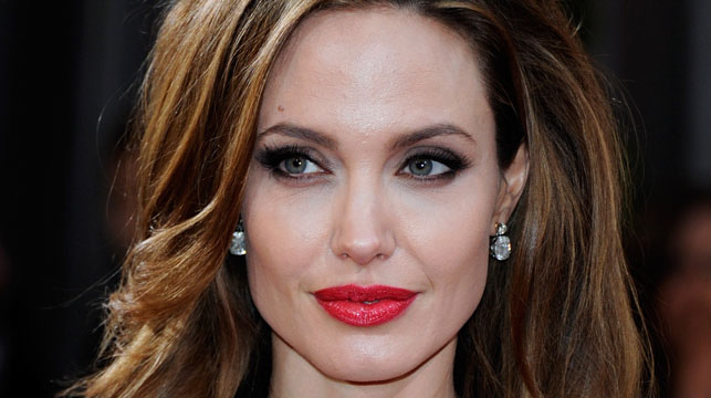 Angelina Jolie has shed tears on the red carpet of the world premiere of her new film, 'Unbroken'. (Getty)