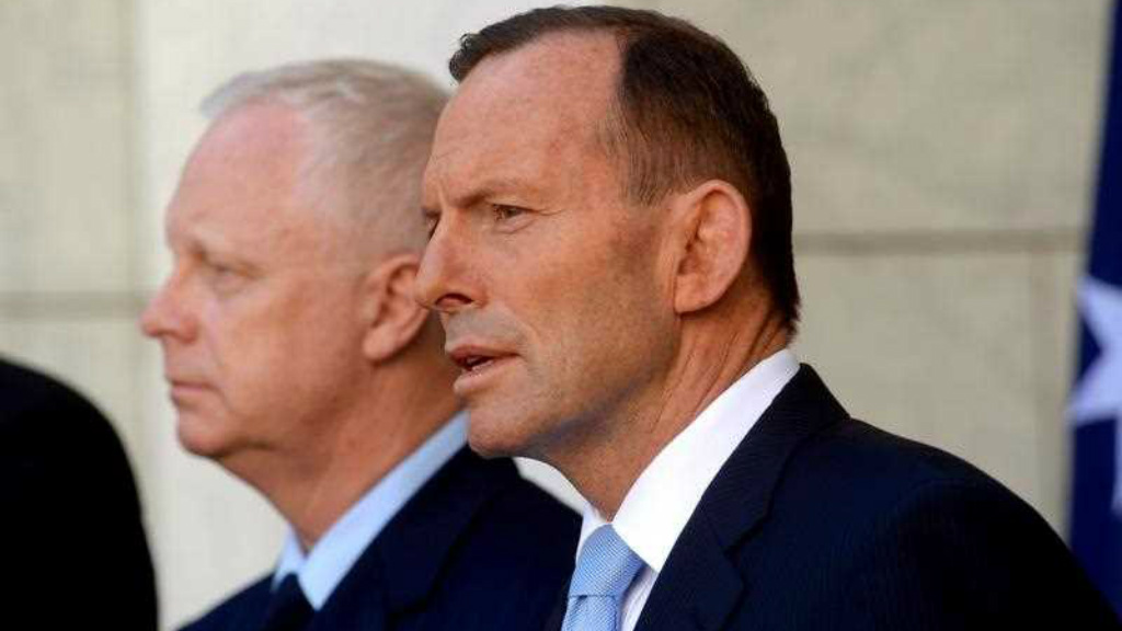 Prime Minister Tony Abbott and Air Chief Marshal Mark Binskin announce combat in Iraq to start in coming days. (AAP)