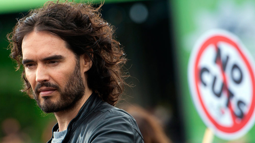 Russell Brand has criticised global politics and world leaders in his new book, Revolution. (AAP)