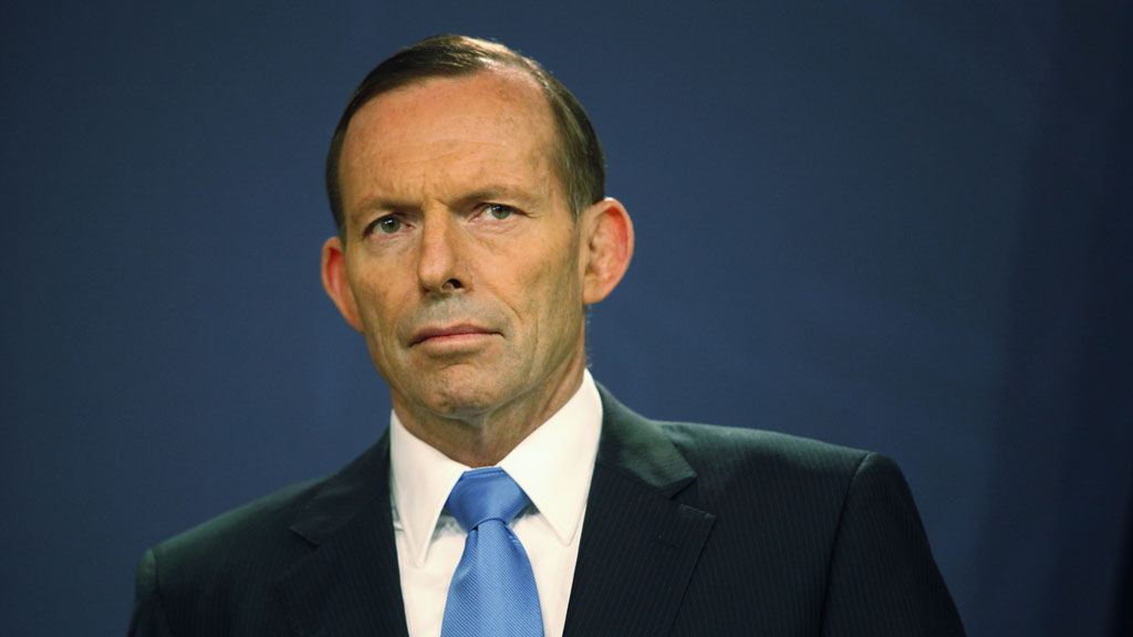 """Prime Minister Tony Abbott has been labelled a """"raving lunatic"""" by entertainer turned author, Russell Brand. (AAP)"""