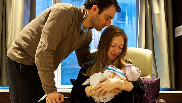 Chelsea Clinton posted this picture of her holding Charlotte with new father Marc Mezvinsky standing behind her. (Supplied)