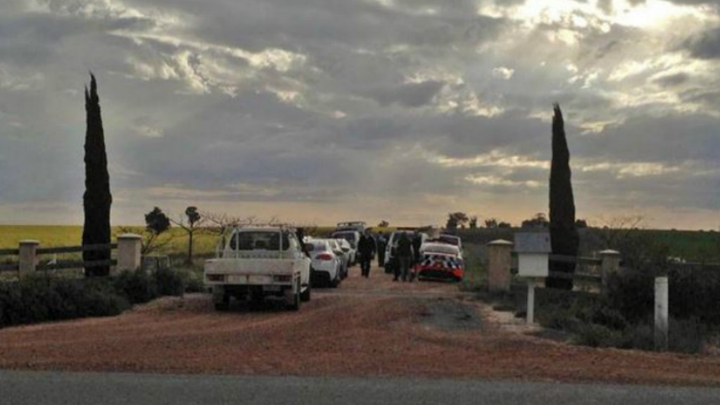 Police at the entry to the property in the NSW Riverina district where a woman and three children have been shot dead. (Andrew Pearson/The Daily Advertiser)