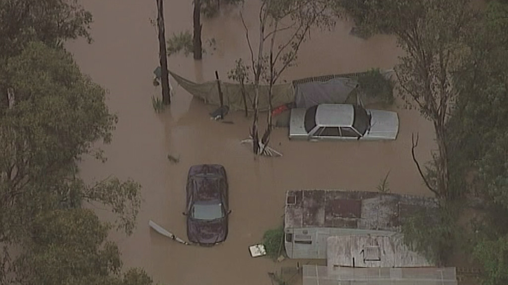 The Georges River has broken its banks, flooding suburbs in Sydney's southwest. (9NEWS)