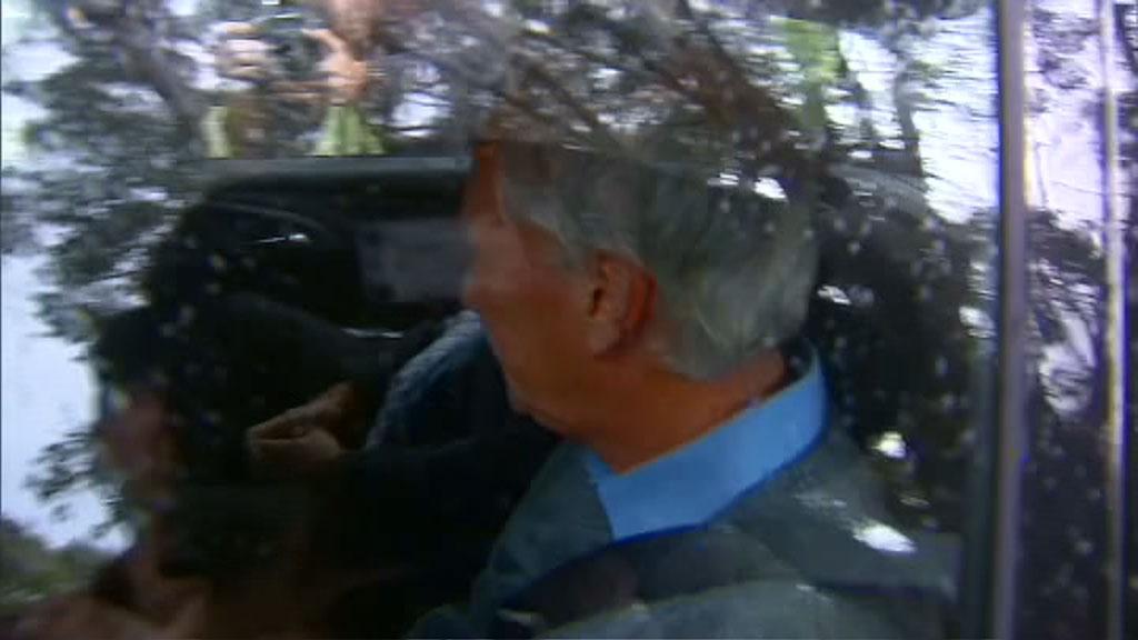 Mr Spedding in the back of the police car. (9NEWS)