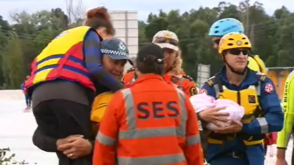 A four-month-old baby was evacuated during a flood rescue operation near Maitland. (9NEWS)