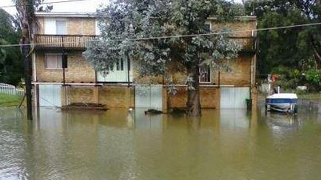 A home in Milperra remains partly underwater after the Georges River broke its banks. (Supplied)