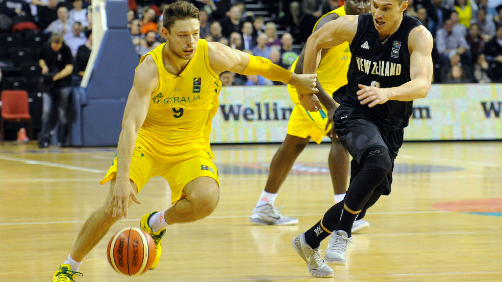 Australia's Matthew Dellavedova, left, runs around New Zealand's Jarrod Kenny.