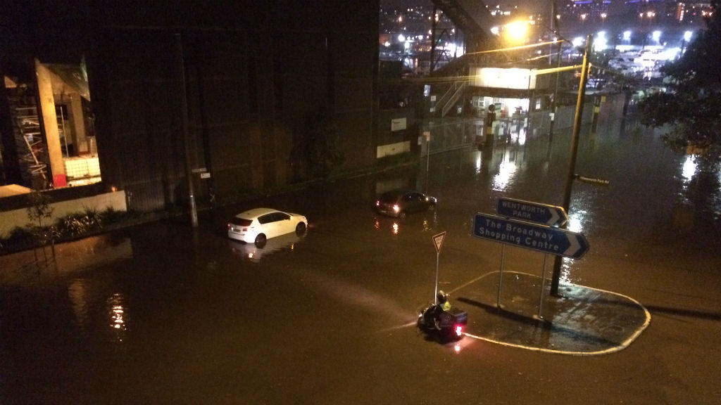 9NEWS reader Robert Anderson sent in this photo of a motorist stuck in floodwaters in Glebe in Sydney's inner-west.