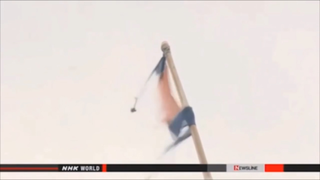 The remains of what appears to be a North Korean flag. (NHK)