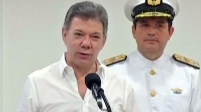 Columbian President Juan Manuel Santos (left).