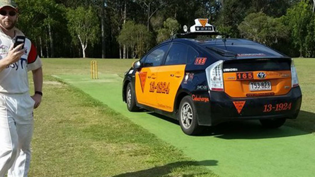 Irate cabbie drives onto Brisbane cricket pitch after ball hits taxi