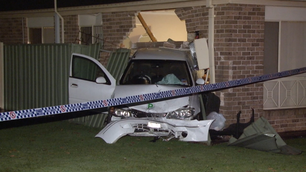 A Green Valley woman has been taken to hospital after a car slammed into her home. (9NEWS)