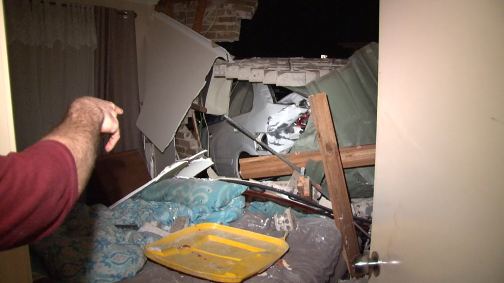 The woman was sleeping in her bedroom when the car crashed through the wall. (9NEWS)