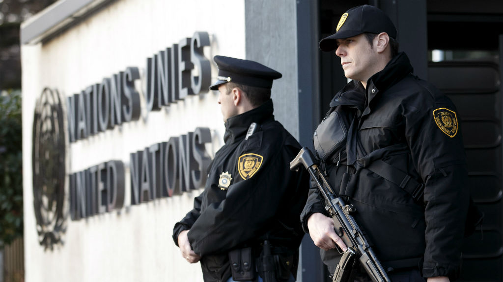 Threat level raised as police search Geneva for suspected jihadists