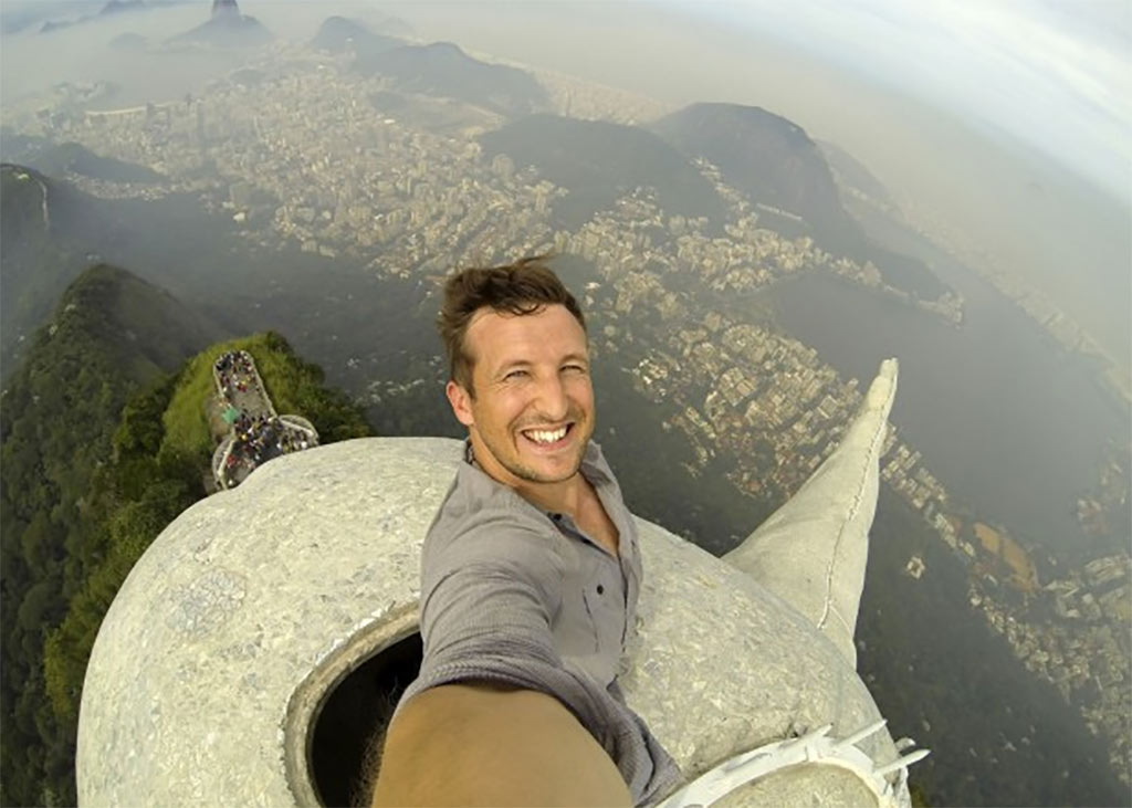 Lee Thompson was able to snap an amazing selfie after being givern permission from Brazil's Tourism Board to climb to the top of Christ the Redeemer