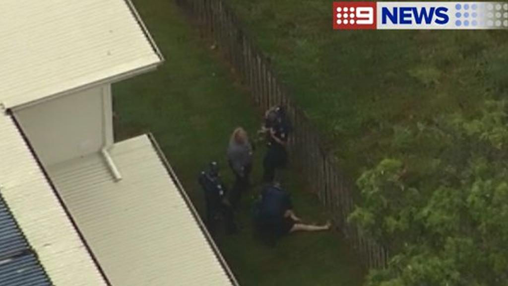 Police arrest a man at Coomera Waters following an extensive search through the area. (9NEWS)