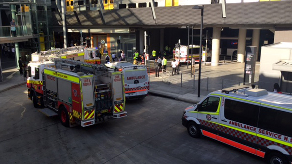 Six people injured after bus slams into wall at train station in Sydney's north