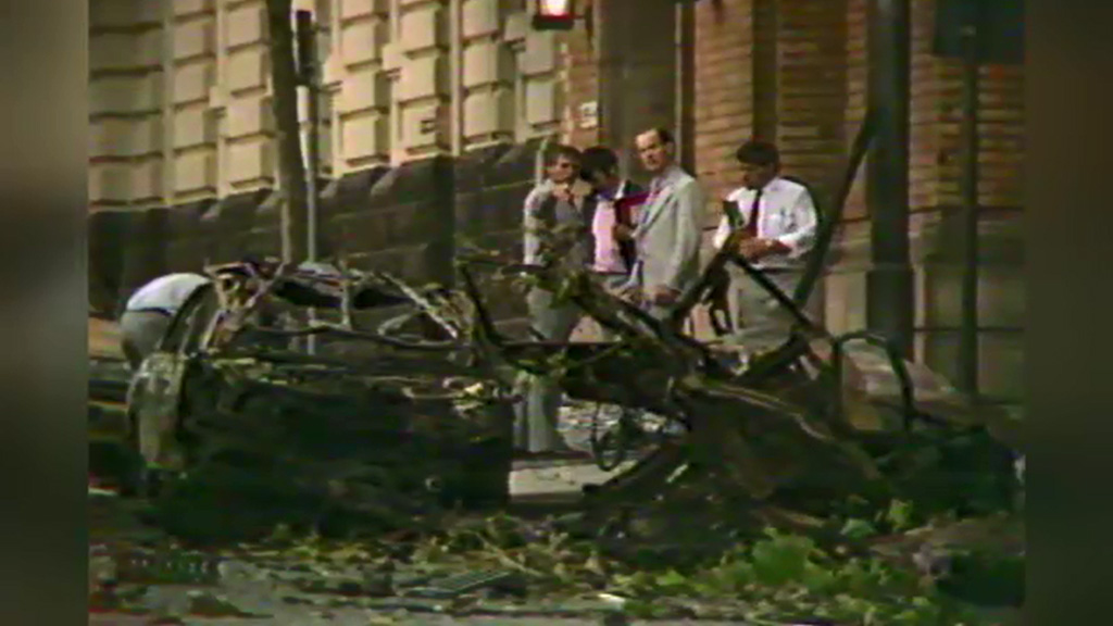 One person was killed and many others were injured after a car loaded with explosives was detonated outside the police headquarters. (9NEWS)
