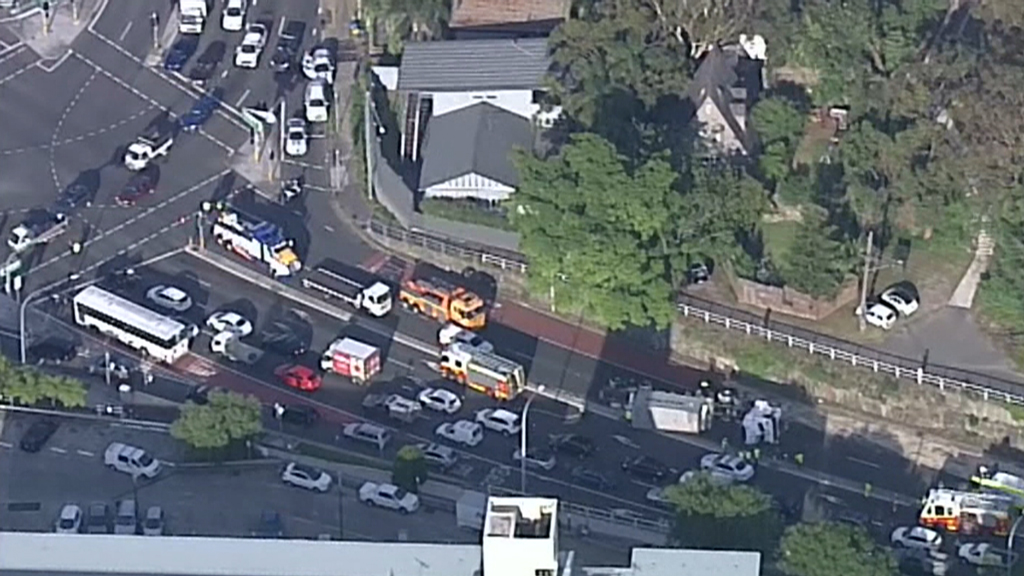 A truck has rolled over on Pittwater Road at Warringah Road, Dee Why. (9NEWS)