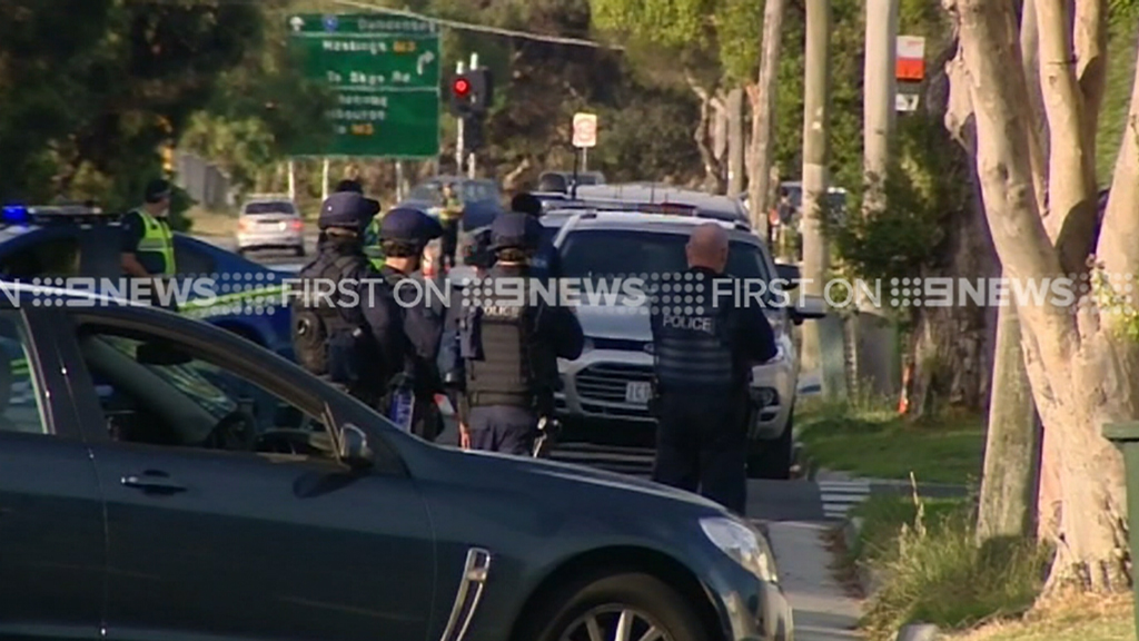 Armed police surrounded the home. (9NEWS)