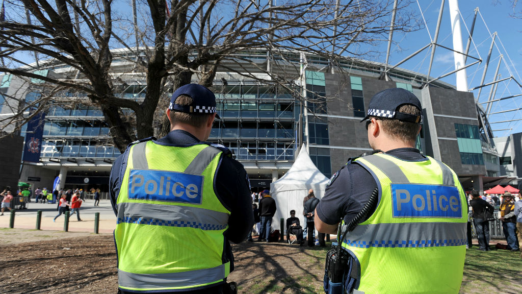 Two police officers stand outside the MCG. (AAP)