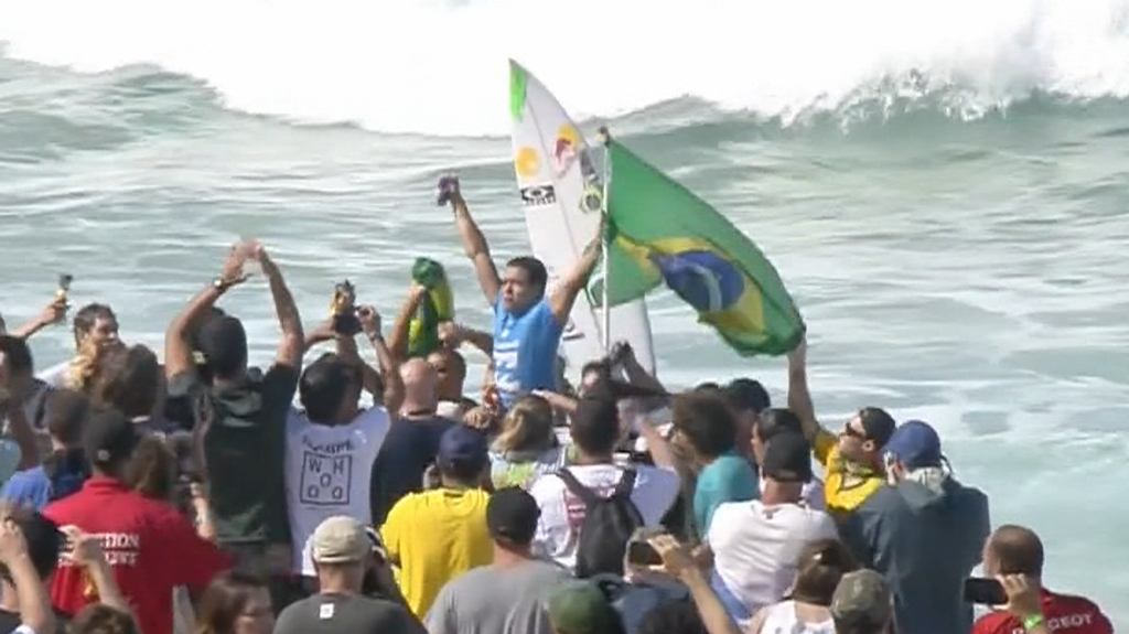 Brazil's Adriano de Souza wins his first world surfing title at Pipeline, narrowly beating Mick Fanning