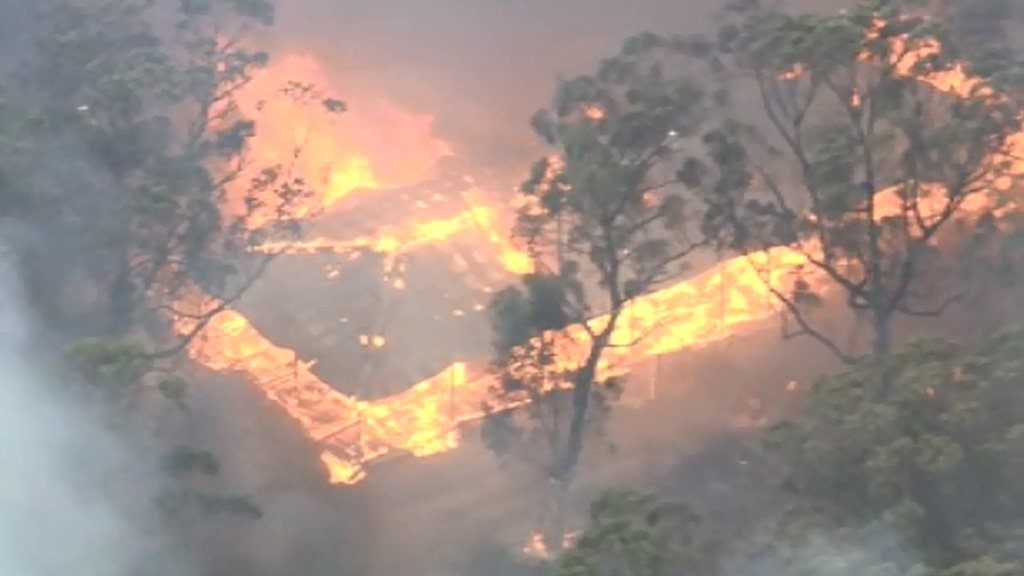 The fully-engulfed building is believed to be a shed or storage facility. (9NEWS)