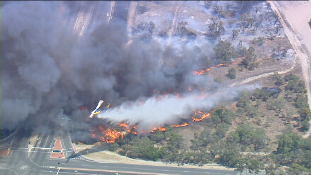 Firefighters are desperately trying keep the fire back. (9NEWS)