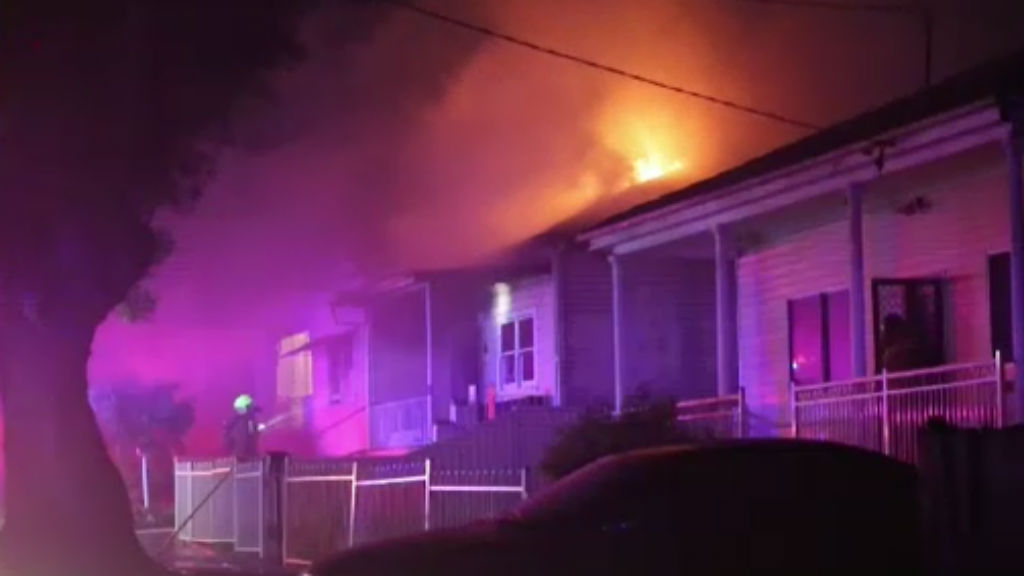 A house alight in Granville was one of three house fires in Sydney overnight. (9NEWS)