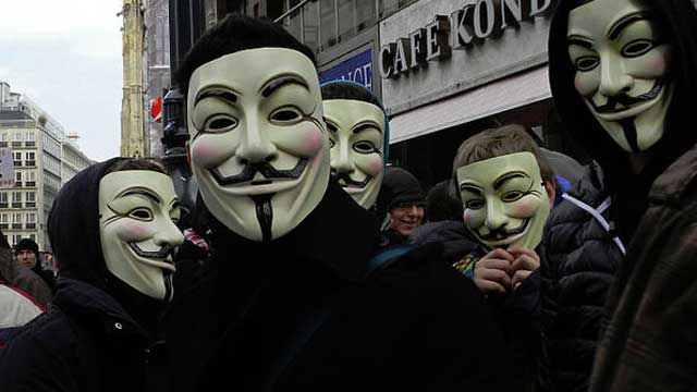 Protestors wear masks of hacker group Anonymous. Source: AAP.