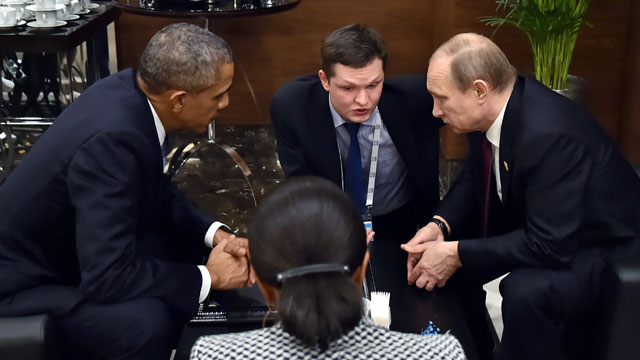 US President Barack Obama speaks with Russian President Vladimir Putin, at the 2015 G-20 summit in Turkey. Source: AAP.