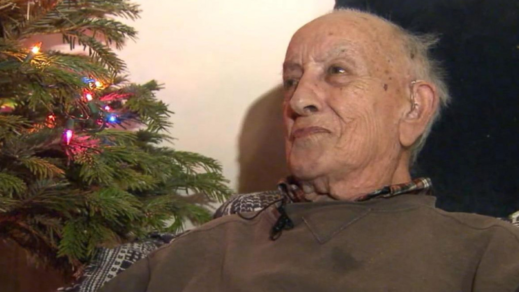 LAPD officers surprise lonely elderly war veteran with Christmas tree and gifts
