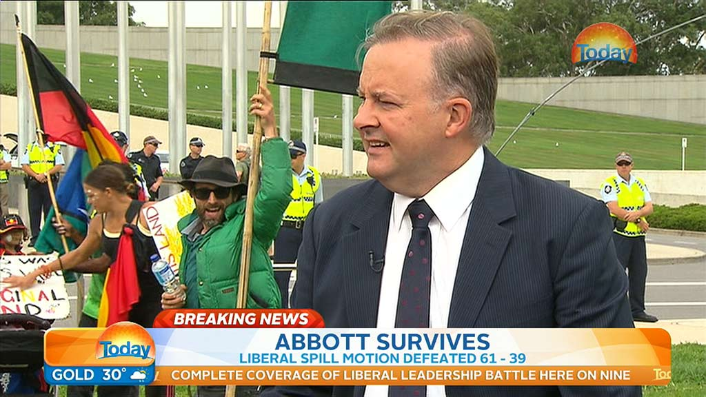 One protester takes advantage of the camera's position. (9NEWS)