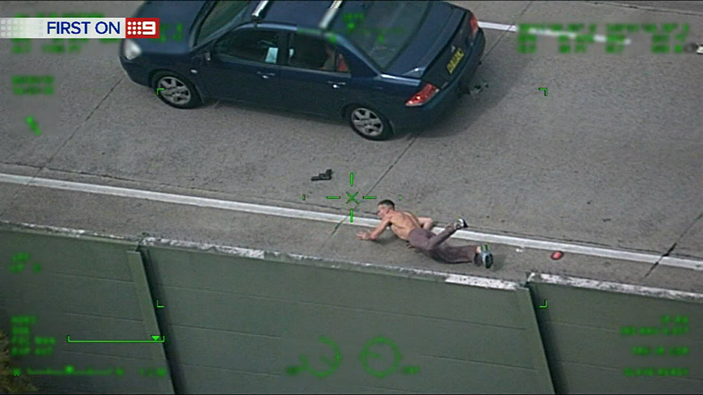He is thrown to the ground by the impact. (9NEWS)