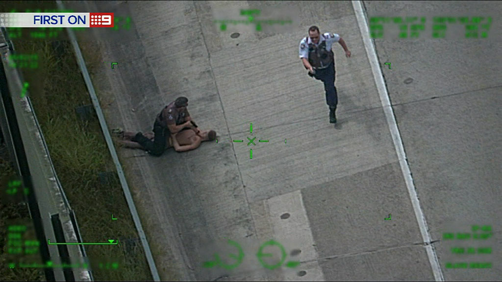 He is apprehended by police. (9NEWS)