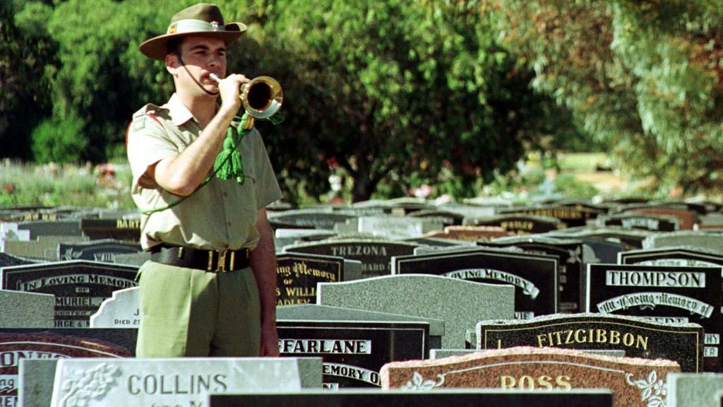 A lone bugler sounds the 'Last Post' at Centennial Park. (AAP)