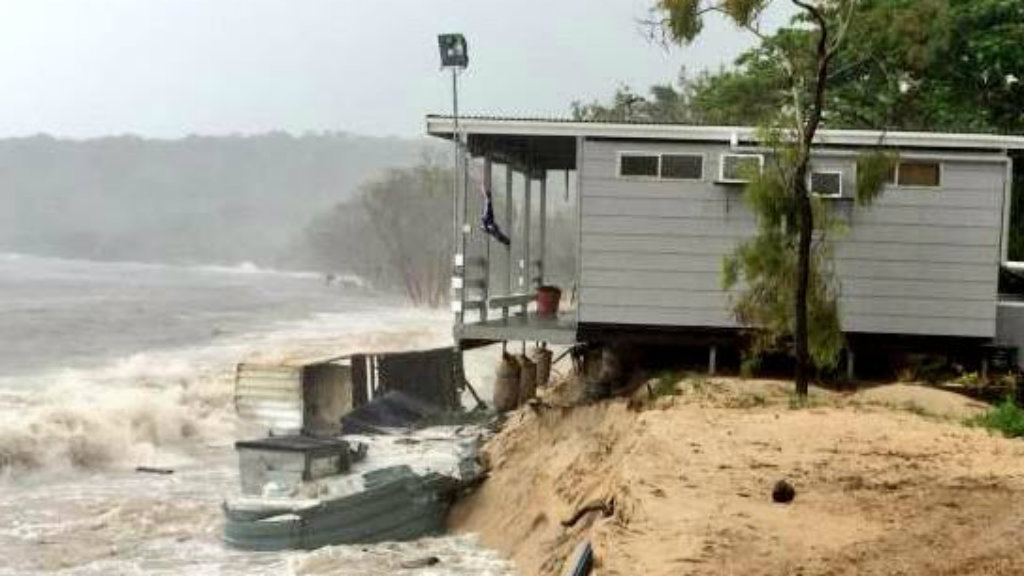 Part of a home on Great Keppel Island is collapsing into the see as Cyclone Marcia pounds its barricades away. (Supplied)
