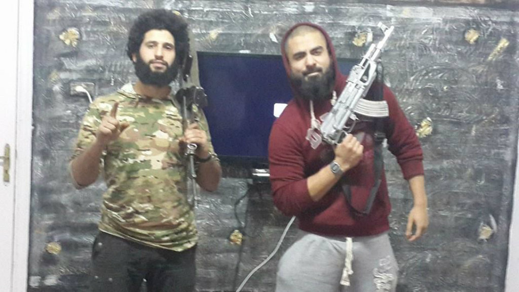 Suhan Rahman (right) with poses with a silver-plated AK47. (Facebook)