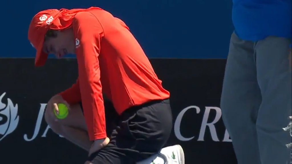 The ball boy struggled from the court after a few minutes.
