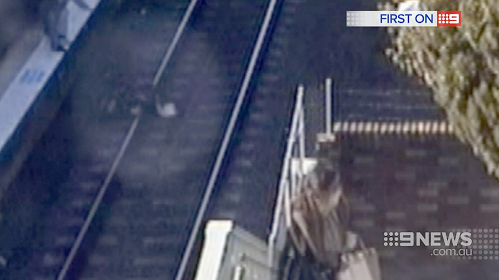 The pram lies on the tracks at Wentworthville station. (9NEWS)