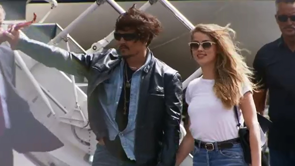 Johnny Depp's wife Amber Heard ordered to face trial in April for allegedly smuggling pet dogs into Australia