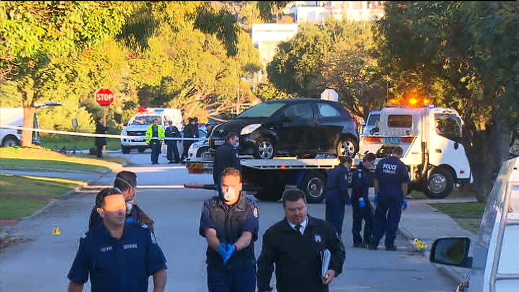 Police at the Mosman Park home in June last year. (9NEWS)