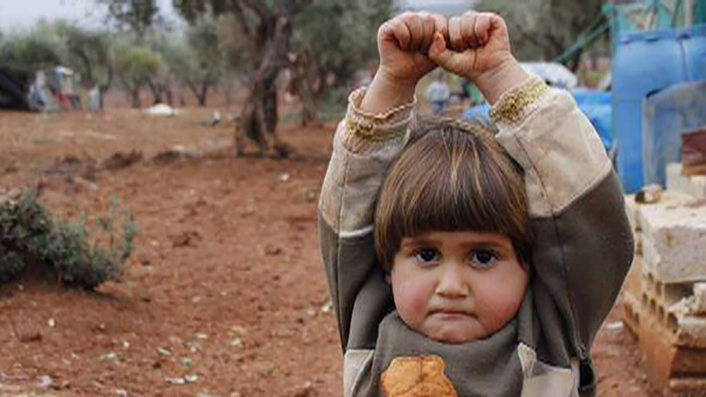 Syrian child mistakes camera for weapon in disturbing photo