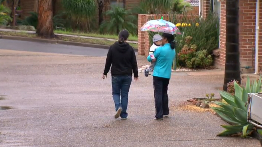 Aidan Fenton's father with a family friend today. (9NEWS)