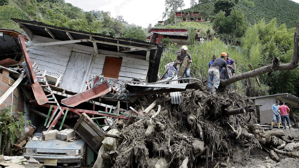 Rescue workers search for survivors. (AAP)