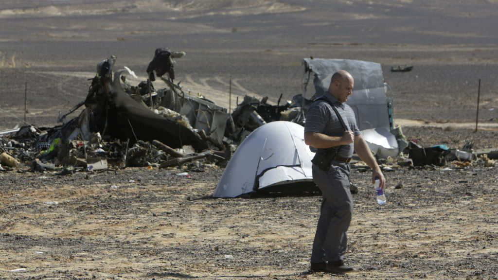 A Russian investigator walks near wreckage. (AAP)