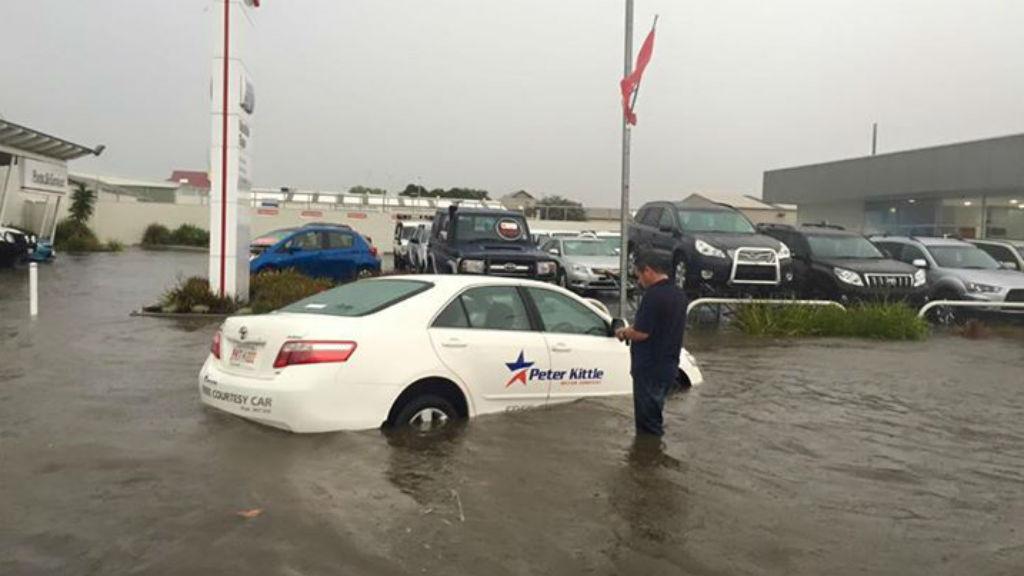 A car semi-submerged near a car dealersip in Port Lincoln. (Facebook/Amy Foureur)