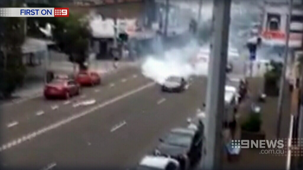 Smoke can be seen pouring from the car. (9NEWS)